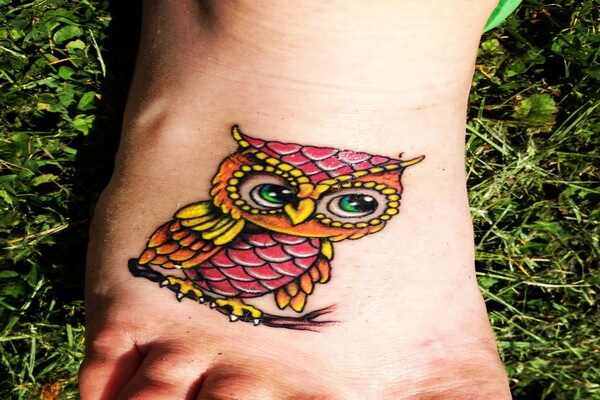 Что означает тату сова на ноге