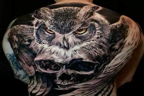 Что означает тату совы на спине
